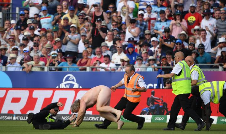 A streaker disrupts play during the Cricket World Cup fixture between England and New Zealand.