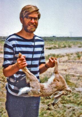John Flux in Iran in 1977 with a road kill hare