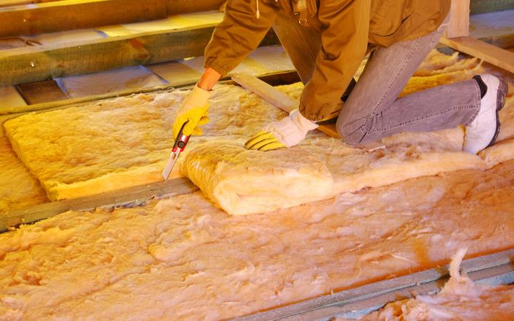 13174303 - construction worker thermally insulating house attic with glass wool