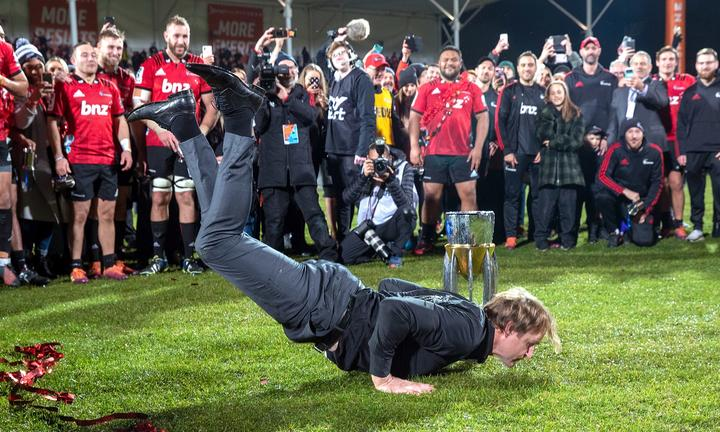 Crusaders coach Scott Robertson displays his trademark breakdancing routine after the Crusaders' 19-3 win over the Jaguares in the Super Rugby final.