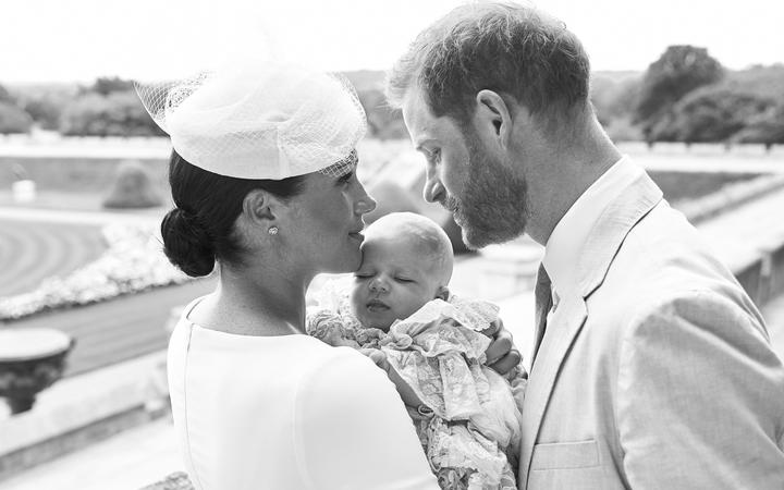 e Duke and Duchess of Sussex shows Britain's Prince Harry, Duke of Sussex (R), and his wife Meghan, Duchess of Sussex holding their baby son, Archie Harrison Mountbatten-Windsor at Windsor Castle on July 6, 2019.