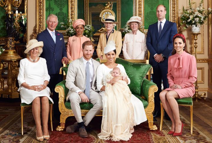 This official handout Christening photograph released by the Duke and Duchess of Sussex shows Britain's Prince Harry, Duke of Sussex (centre left), and his wife Meghan, Duchess of Sussex holding their baby son, Archie Harrison Mountbatten-Windsor