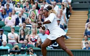 6th July 2019, The All England Lawn Tennis and Croquet Club, Wimbledon, England, Wimbledon Tennis Tournament, Day 6; Serena Williams (USA) with a forehand during her mixed doubles match with Andy Murray