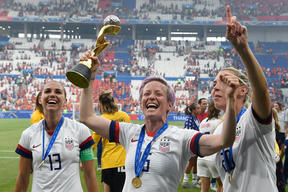 USA's players including Megan Rapinoe , centre, celebrate their World Cup title win.