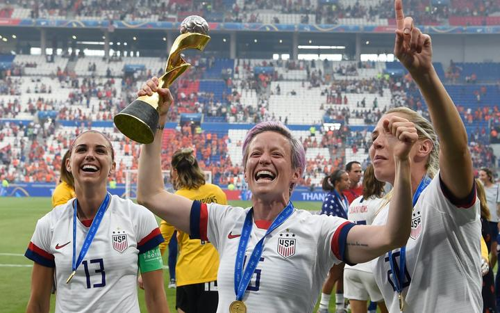 USA's players including forward Megan Rapinoe (C) celebrate with the trophy after the France 2019 Women's World Cup football final match between USA and the Netherlands, on July 7, 2019.