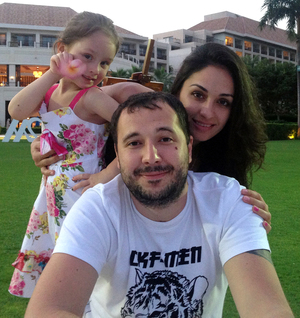 Roman Seleznev, pictured with his family, is currently being held by US authorities on Guam