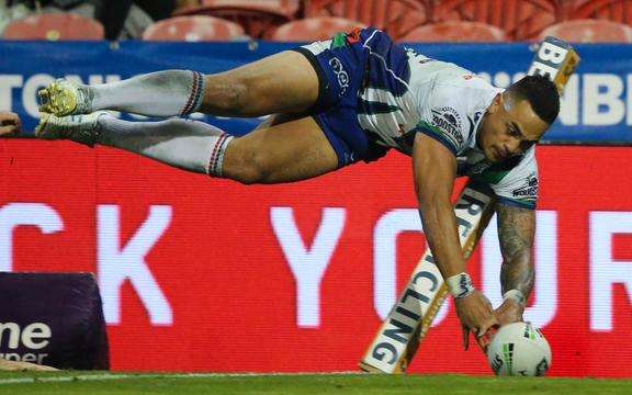 Ken Maumalo dives over in the corner against Newcastle but the try was disallowed.