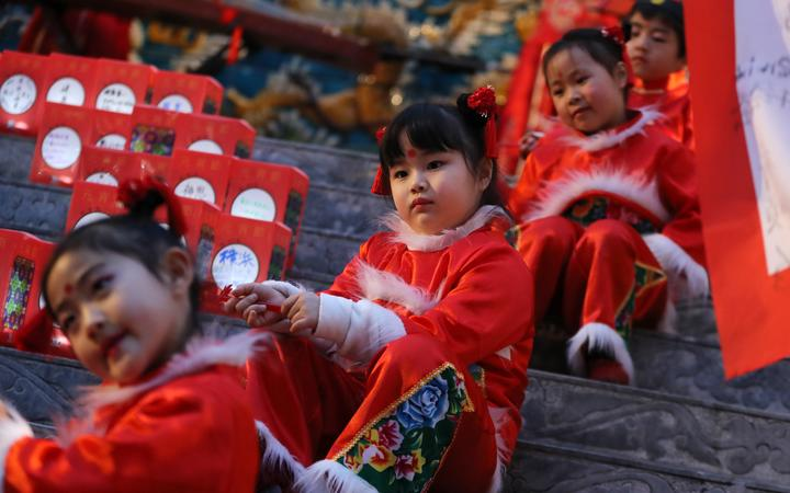 Children perform at the lantern festival, marking the last day of the Chinese new year, at Chinatown in Yokohama, Japan in  February 2019.