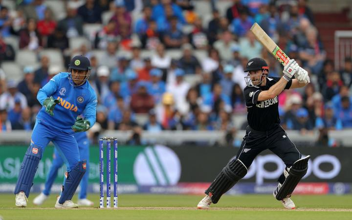 Indian wicket keeper Mahendra Singh Dhoni and New Zealand Captain Kane Williamson bats during the Cricket World Cup 2019 semi-final between India and New Zealand at Old Trafford, Manchester on 9 July 2019.