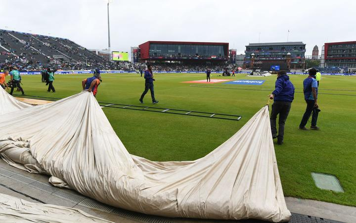 Rain covers heading out to cover the pitch.