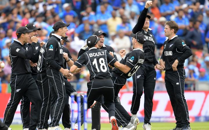 New Zealand's Martin Guptill (2R) celebrates with teammates after running out India's Mahendra Singh Dhoni for 50 during the 2019 Cricket World Cup first semi-final between New Zealand and India at Old Trafford in Manchester.