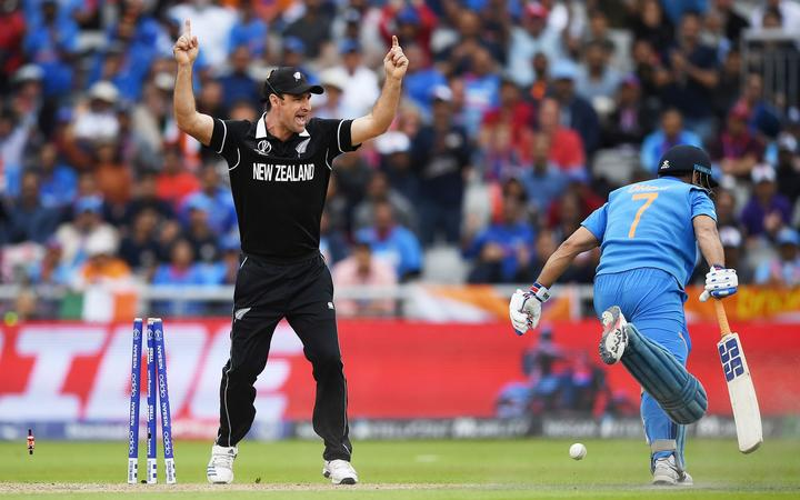 Colin de Grandhomme celebrates the run out of MS Dhoni after a direct hit by Martin Guptill.