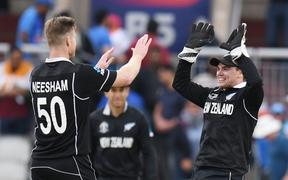 New Zealand's James Neesham (L) celebrates after taking the final wicket of India's Yuzvendra Chahal and winning the 2019 Cricket World Cup first semi-final between New Zealand and India at Old Trafford in Manchester, northwest England, on July 10, 2019.
