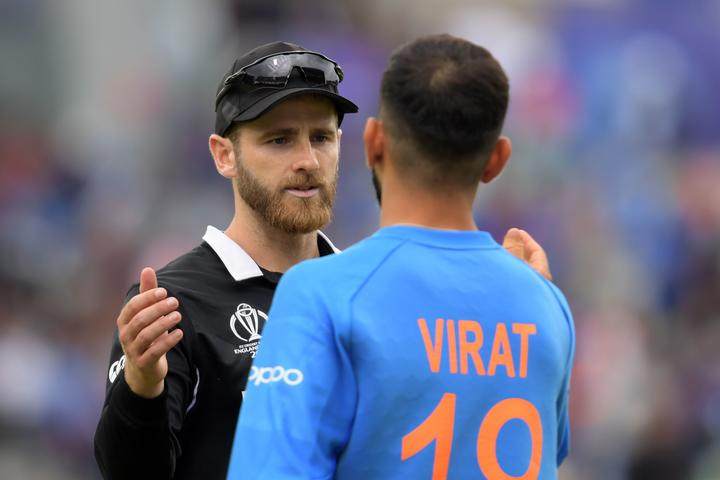 New Zealand's captain Kane Williamson (L) greets India's captain Virat Kohli at the end of play during the 2019 Cricket World Cup first semi-final between New Zealand and India at Old Trafford in Manchester, northwest England, on July 10, 2019.
