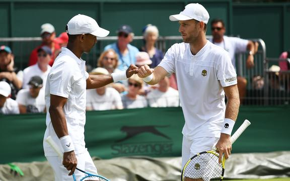 New Zealand's Michael Venus (R) and South African doubles partner Raven Klaasen during the Wimbledon Tennis Championships.