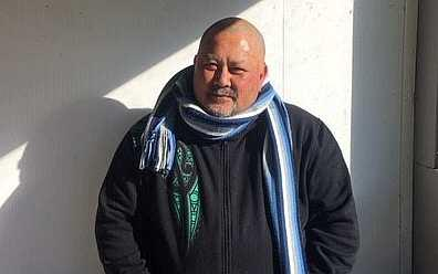 Maori man with scarf around neck