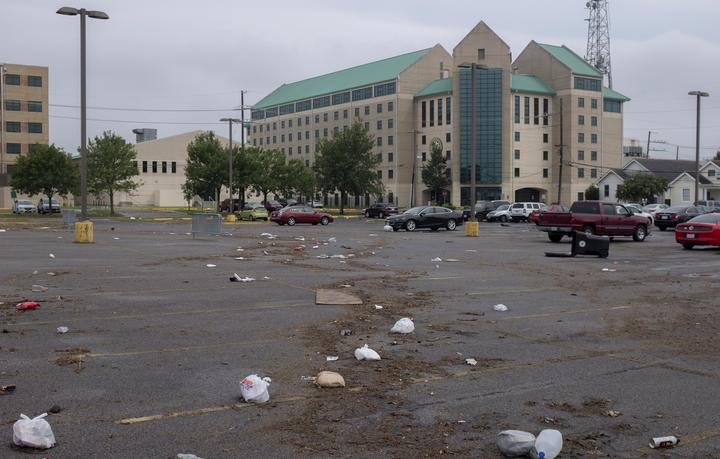 Debris is strewn across a parking lot in New Orleans after flash floods struck the area early on July 10, 2019.