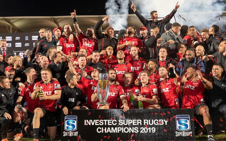 The Crusaders celebrate their win after taking out the 2019 Super Rugby title.