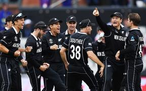 The Black Caps celebrate the run out of M S Dhoni at Old Trafford.