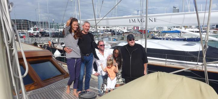 Mikhail Khimich with his girlfriend, Belarussian model Maria Dzidirava, and Kim Dotcom on Khimich's super yacht Thalia.