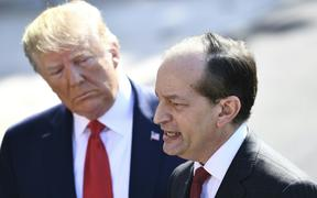 US President Donald Trump (L) listens to US Labor Secretary Alexander Acosta as he speaks to the media early July 12, 2019 at the White House in Washington, DC.