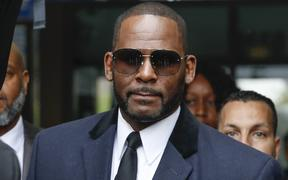 R. Kelly leaves a courthouse after an earlier hearing.