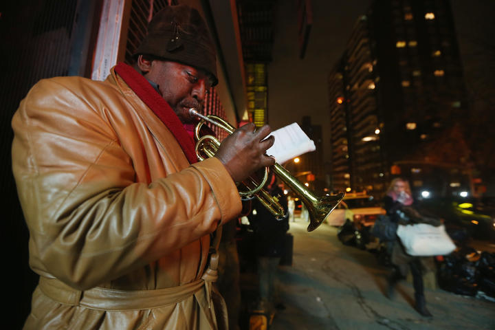 Benjamin Norris Scott plays music on Avenue C in Lower Manhattan's East Village a few hours after power was restored to the neighborhood.