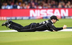 Lockie Ferguson takes a catch to take the wicket of Morgan at the Cricket World Cup final.