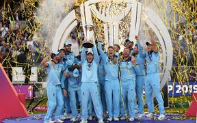 England Captain Eoin Morgan lifts the ICC Cricket World Cup trophy.