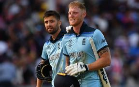 England's Ben Stokes (R) reacts in frustration as he loeaves the pitch with England's Mark Wood ahead of a 'super over' during the 2019 Cricket World Cup final between England and New Zealand at Lord's Cricket Ground July 14, 2019.