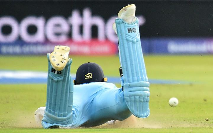 The ball hits England's Ben Stokes, deflecting to reach the boundary as he dives to make his ground during the 2019 Cricket World Cup final.