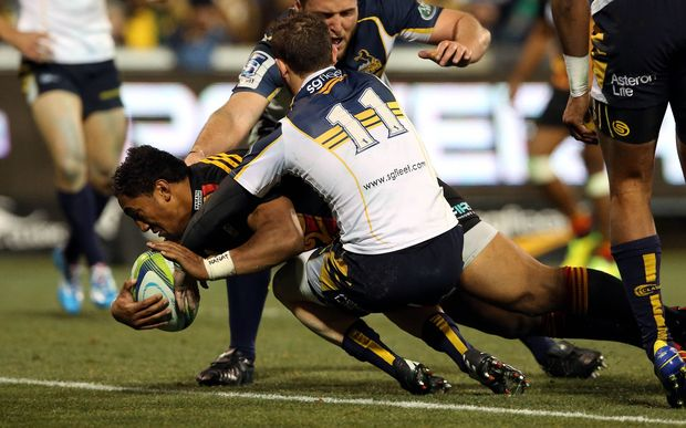 Bundee Aki scores through Robbie Coleman. Super Rugby union qualifying finals match, Brumbies v Chiefs, Canberra, Australia.