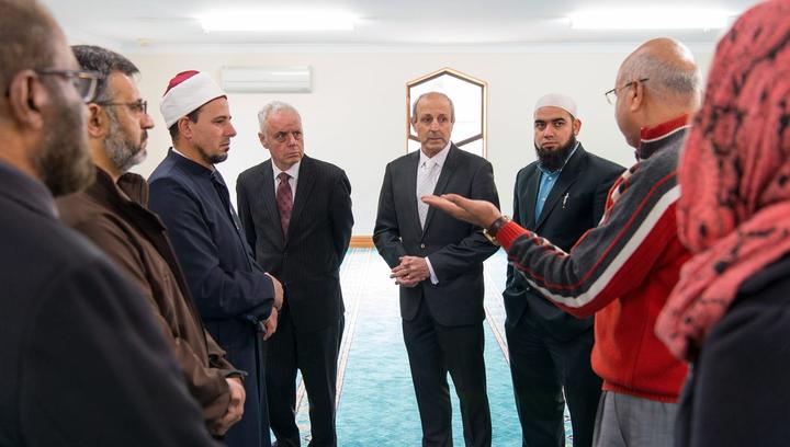 Dr Anwar Ghani (red) takes the Jewish visitors on a tour of a Christchurch Mosque.