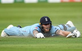 Ben Stokes dives to make his ground during the final.
