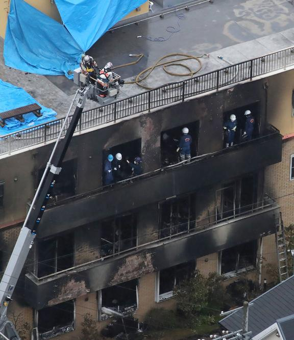 This aerial view shows the rescue and recover scene after a fire at an animation company building killed some two dozen people in Kyoto on July 18, 2019.