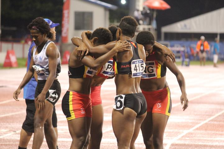 PNG celebrate defending the women's 4x400m relay title.