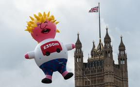 "Boris Blimp balloon depicting Tory leadership hopeful Boris Johnson flies next to the Houses of Parliament ahead of anti-Brexit ""Yes to Europe, no to Boris"" demonstration on 20 July, 2019 in London, England."