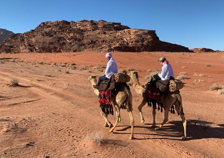 Andrew Bayly and his son Dan on camels.