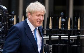 Boris Johnson leaves Conservative party headquarters in central London after party members voted him next Tory leader and UK prime minister.
