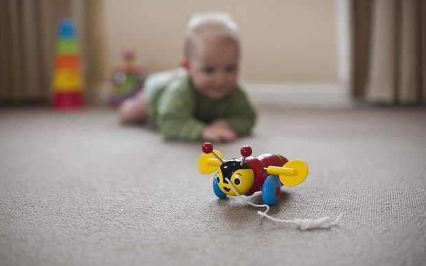 Baby with buzzy bee toy.
