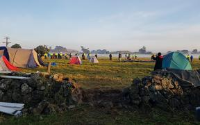 A piece of wall has been removed to allow acces to the paddocks at Ihumātao.