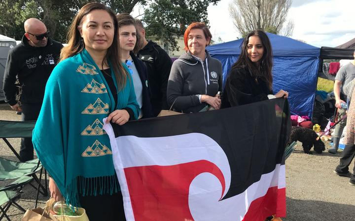 Green Party MPs Marama Davidson, Chloe Swarbrick and Golriz Ghahraman at Ihumātao on 26 July.