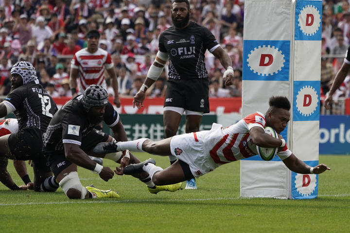 Japan's Kotaro Matsushima scores as his side defeats Fiji 34-21 at Kamaishi Recovery Memorial Stadium