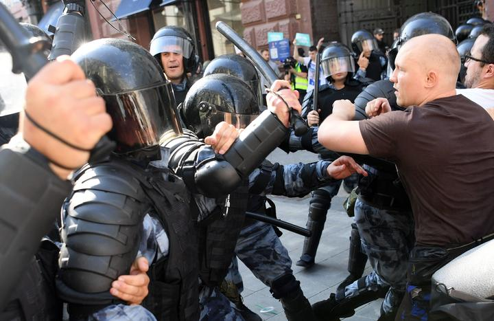 Protesters clash with riot police during an unauthorised rally demanding independent and opposition candidates be allowed to run for office in local election in September,