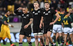 Aaron Smith and team mates show their disappointent at the end of the match after a draw.