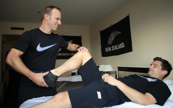 New Zealand Football physio Mark Fulcher treating All Whites keeper Jacob Spoonley in 2014.