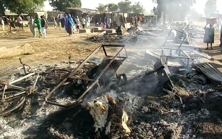 Smoldering ashes and charred items  in Budu near Maiduguri on July 28, 2019, after the latest attack by Boko Haram fighters on a funeral in northeast Nigeria has left 65 people dead.