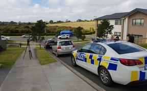 Police at the scene where a woman was fatally assaulted on Westgate Drive in Massey.