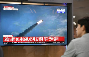 A man watches a television news screen showing file footage of a North Korean missile launch, at a railway station in Seoul on 31 July, 2019.