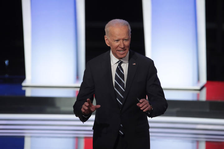 Democratic presidential candidate former Vice President Joe Biden stands on stage after the Democratic Presidential Debate at the Fox Theatre in Detroit Michigan